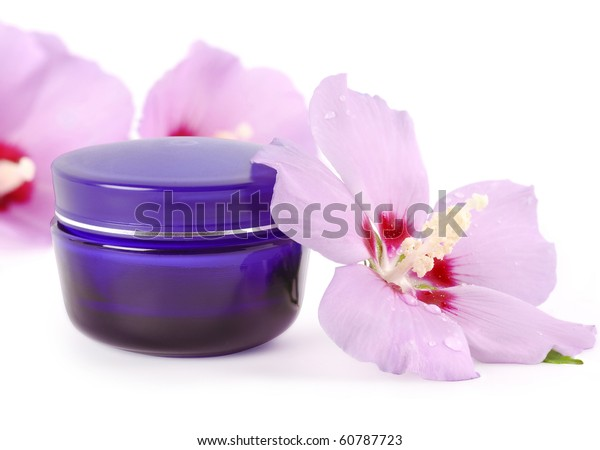 blue jar of cream with delicate flowers