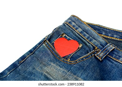 Blue jean isolated on white focus on red heart