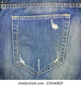 blue jeans back pocket tear old