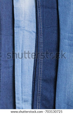0f197619c3 Blue jeans background. Denim texture in 4 blue shades. jeans pants clothes  pile background