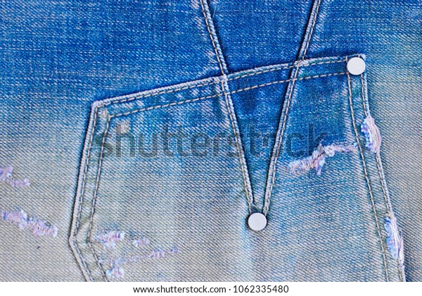 Blue jeans closeup view. Space of empty denim texture for traditional business background in cold bright color