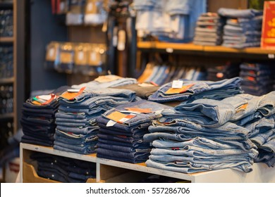 Blue jeans denim Collection jeans stacked,soft focus.