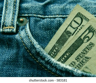 Blue jeans with fifteen American dollars in the front pocket.
