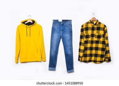 1f4c064c blue jeans and hoodie yellow Sweatshirt and plaid shirt on hanging