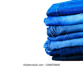 Blue jeans isolated on white background. Jeans stacked.Jeans on a light background.Jeans background.