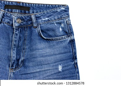 Blue jeans isolated on white background top view flat lay. Detail of nice blue jeans. Jeans texture or denim background. Trend clothing. Beauty and fashion, clothing concept.
