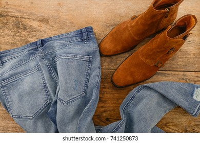 blue jeans with leather shoes on old wooden texture