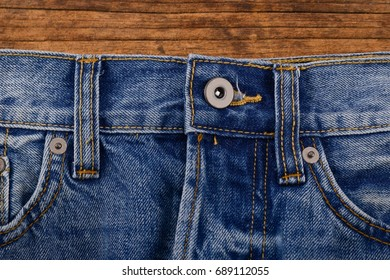 blue jeans on old wooden texture .background