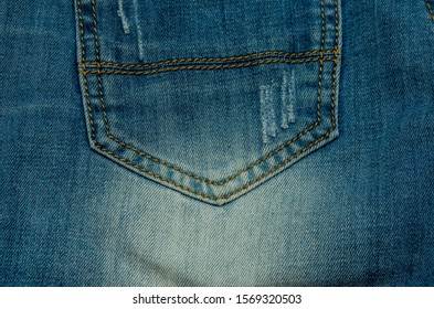 blue jeans pants lie fly  the table