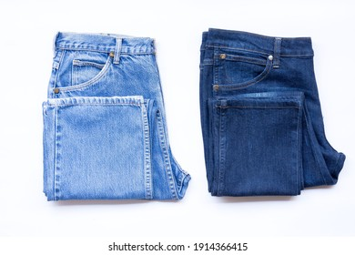 Blue jeans in a row, stack of denim pants, composition, denim texture.