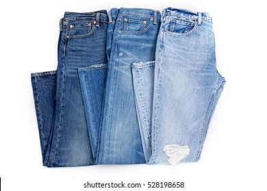 blue jeans in a row, stack of  denim pants, composition, denim texture