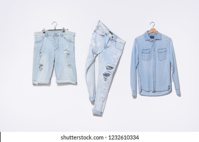 blue jeans shirt and shorts jeans on hanging and blue torn jeans isolated