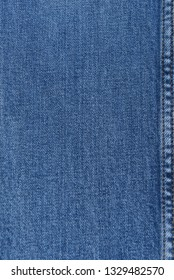 blue jeans texture. Denim jeans texture, denim jeans background with a seam.