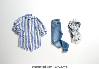 Blue jeans, blue and white striped shirt and scarf isolated on white background.