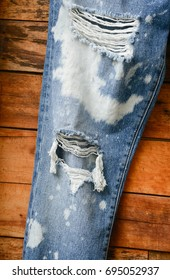 Blue jeans-wooden background