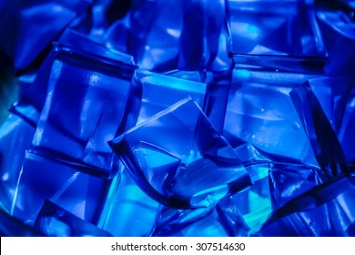 Blue Jell-O gelatin cubes lit from below.