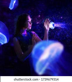 blue jellyfish around the girl
