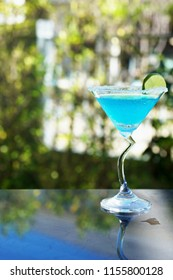 Blue Kamikaze Cocktail in the garden