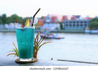 Blue Kamikaze Cocktail  on river view background
