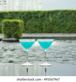 blue kamikaze cocktail with poo view  background - soft and select background