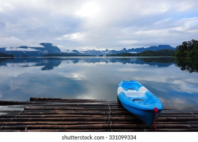 Blue Kayak on Morning after rain in  a beautiful mountains lake forest and river natural attractions in Ratchaprapha Dam at Khao Sok National Park, Surat Thani Province, Thailand.