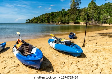 Blue kayaks on Layan beach, Phuket, Thailand. You can find all kinds of water sports you can spend your time on when you are on vacation.
