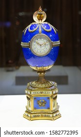 Blue Kelch Chanticleer Fabergé egg with clock and diamond golden baroque style ornatements close up on the Faberge Museum display. St. Petersburg, Russia 5 December 2019