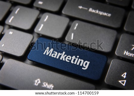 Blue key with marketing text on laptop keyboard. Included clipping path, so you can easily edit it.