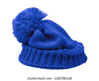 Blue Knit Wool Hat with Pom Pom isolated on white background