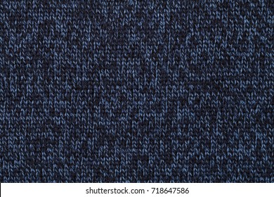Blue knitted fabric made of heathered yarn textured background