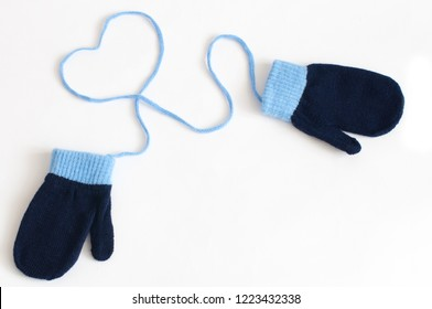 Blue knitted mittens isolated on a white background. Winter symbol.