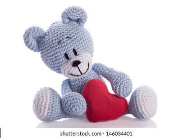 blue knitted teddy bear with red heart