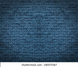 Blue knitting wool texture background.