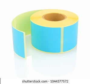 Blue label roll isolated on white background with shadow reflection. Color reel of labels for printers. Labels for direct thermal or thermal transfer printing. Blue stickers on white backdrop.