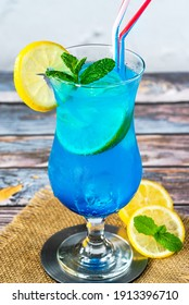 Blue Lagoon cocktail of blue curacao syrup mixed with vodka and lemonade