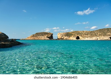 A blue lagoon with crystal clear azure-coloured water that's located on the coast of the island of Comino, between Malta and Gozo. It is a great place  to relax, swim and snorkel. Vacation in Europe.