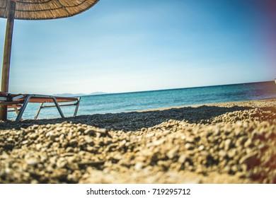 Blue lagoon exotic beach in Greek islands, wild exotic beach, rocks blue sea mountain landscape in Greek Samothraki hot summer travel background