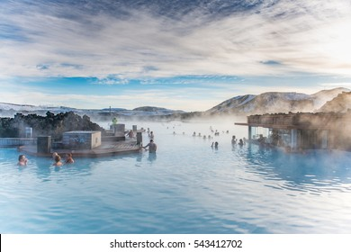 BLUE LAGOON, ICELAND - February 08: People bathing in The Blue Lagoon, a geothermal bath resort in the south of Iceland, a 'must see' by tourists. February 08, 2016 in Iceland.