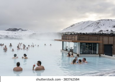 Blue lagoon, Iceland - February 20, 2016: People in SPA are drinking cocktails near  a cafe on the water