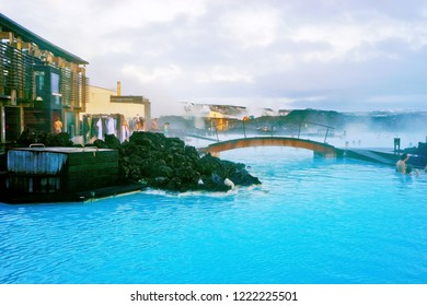 Blue Lagoon, Iceland - January 27, 2017: View of the Blue Lagoon pool and visitor's building at dusk with lots of tourists bathing in Blue Lagoon, Iceland on January 27, 2017.