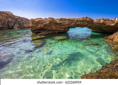 Blue Lagoon, Malta - The arch of the Blue Lagoon on the island of Comino on a bright sunny summer day with blue sky