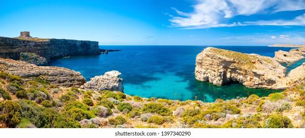 Blue lagoon. Malta. Comino island. Picturesque landscape with sea bay on a sunny day. Panorama of Malta coastline. Summer background. Famous destination in europe Malta.