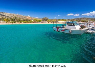 Blue lagoon of Marathi bay with fishing boats on Crete, Greece