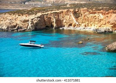 Blue Lagoon on a sunny day in APRIL 13, 2016 in Comino island, Malta.