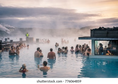 BLUE LAGOON, Reykjanes Peninsula, Iceland - December 2017. People bathing in  the hot waters of geothermal bath resort.
