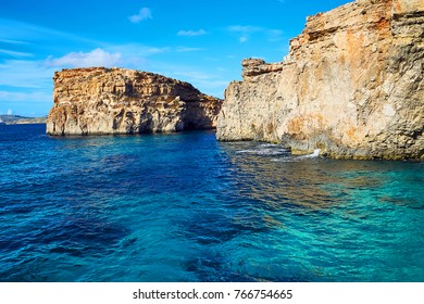 blue lagoon with rocks in the background. island of comino. malta.