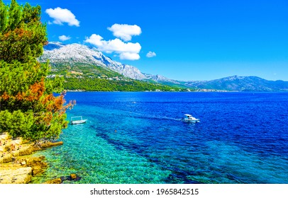 Blue lagoon in sea bay. Boat in blue lagoon. Mountain sea bay landscape. Sea bay in mountains