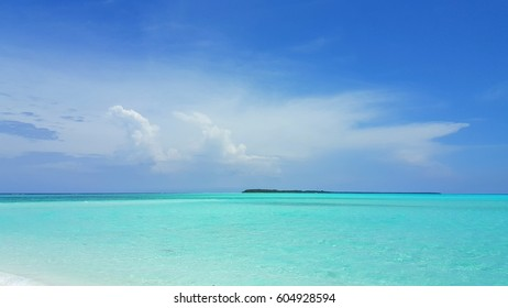 Blue lagoon sea with sky background