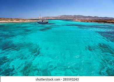 Blue lagoon in Tigani islet between Paros and Antiparos islands, Cyclades, Greece, with clear transparent turquoise waters