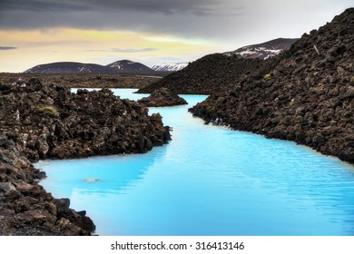 Blue lagoon waters in the lava field landscape of Iceland in winter, HDR
